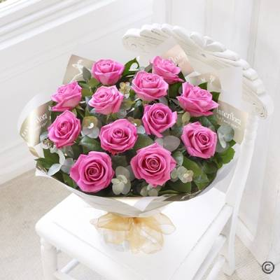 Sending a dozen Pink Roses is such a stunning gift! Sandra's Florist will select twelve of the finest, large-headed Pink Roses to create a hand-tied bouquet guaranteed to delight.