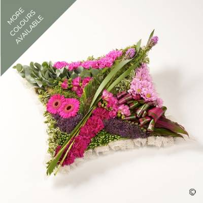 This striking contemporary cushion-shaped design, is created using a selection of flowers including Freesia, Carnations, Mini Gerbera, Chrysanthemums and many more, along with a collection of complimenting foliage. The tribute is skilfully arranged by Sandra's Florist and is available in two colours, bright pink or Vibrant tones.