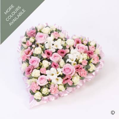 A heart-shaped design is available in two soft pastel tones, shades of pink and white or lilac and white. The flowers carefully selected by Sandra's Florist include large-headed Roses, Lisianthus, Spray Carnations, along with other complimenting flowers and a foliage to complete this beautiful design.