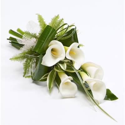 Classic white calla lilies tied with a natural ribbon are complemented with a selection of foliage including folded aspidistra leaves to create this contemporary sheaf that will be carefully hand delivered by Sandra's Florist.  Approximate Product Dimensions:  Length: 70cm Width: 30cm 5 Stems