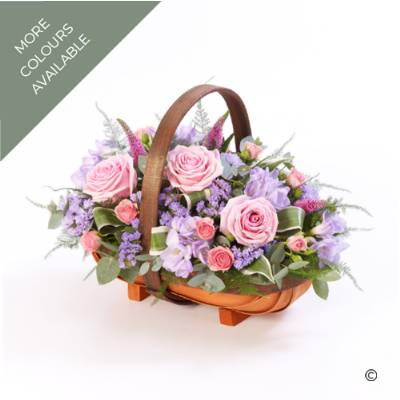 A traditional trug basket filled with roses, veronica, statice and scented freesia. Available in pinks and lilacs or white, cream & green. A beautiful traditional yet, less formal design that will be carefully created by Sandra's Florist.