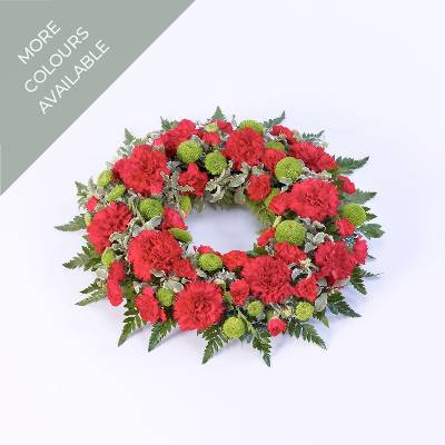 A classic selection of Carnations and spray carnations with complimenting foliage nestled into this traditional circular wreath. Sandra's Florist can create this tribute in different colour options: Red, Pink, White, Yellow and Orange.