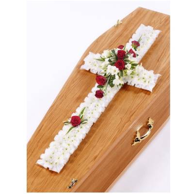 This classic cross is massed with a base of white Spray Chrysanthemums, this gives the perfect backdrop to the spray of roses, freesias and complimenting foliage that complete this attractive traditional design. Sandra's Florist will skilfully create and carefully hand deliver this tribute.