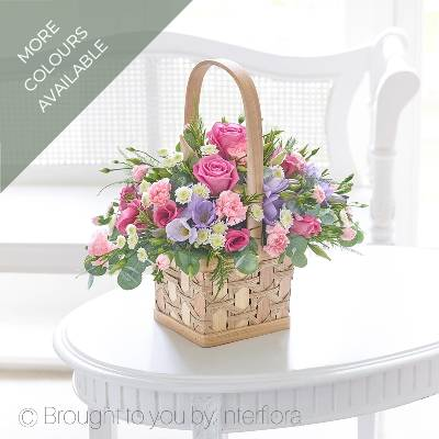Allow Sandra's Florist to hand deliver this gift that looks and smells delightful, they're sure to be impressed with your choice. This charming basket is a beautifully arranged selection of delicate pink, lilac and cream flowers – and the soft fragrance is thanks to these gorgeous freesias. Perfect!