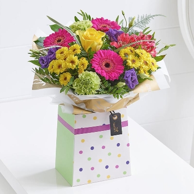 A cheerful and bright tied arrangement of the freshest flowers. This design is presented in a gift box, making it very easy to look after. Delivered with care by Sandra's Florist a perfect gift for Mothers Day.