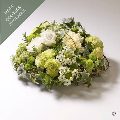 This natural posy is perfect for a nature or garden lover. The large-headed Roses, Carnations, Spray Chrysanthemums and delicate choice accompanying flowers are grouped within the design that includes moss, Ivy trails and other natural foliage to create this natural feeling posy design. Sandra's Florist can skilfully create the posy in two colour tones white, cream and green, or pink, cream and green.