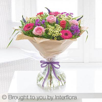 Our Summer Adventures Hand-tied featuring a beautiful selection of summer flowers including pink large headed roses, cream spray chrysanthemums, cerise germini and cerise roses with other complimenting flowers and foliage. The bouquet will be skilfully created by one of the Sandra's Florist team and carefully gift wrapped to complete this stunning design.