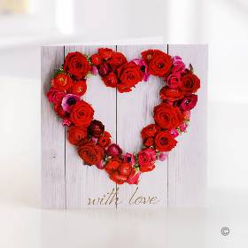 This stylish 'with love' greetings card features a lovely heart shaped selection of red roses. One of the Sandra's Florist team will carefully handwrite your personal message inside and send it with your gift choice. The card is 15cm x 15cm and arrives in an envelope.