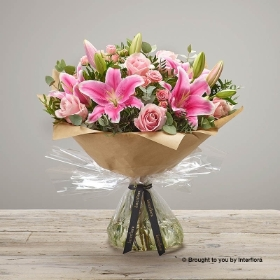 This is a truly spectacular combination of large-headed roses and elegant Oriental lilies. It's easy to see why this is a popular choice. Sandra's Florist will skilfully create these firm favourites of pink large-headed roses and Oriental lilies with complimenting foliage into a simple, and very stylish hand-tied bouquet completed with is a fabulous gift wrapping.