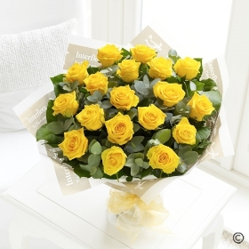 Sending a dozen Yellow Roses is sure to brighten someone's day! Sandra's Florist will select twelve of the finest, large-headed Yellow Roses to create a hand-tied bouquet guaranteed to delight.