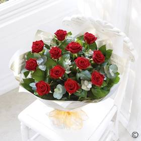 Sending a dozen red Roses says more than words! You can relax in the knowledge that Sandra's Florist will select twelve of the finest, large-headed red Roses to create a hand-tied bouquet guaranteed to take their breath away.  Featuring 12 large-headed red roses hand-tied with complimenting foliage and finished with gift wrap and ribbon.