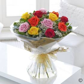 Sending a dozen mixed roses is a truly beautiful gift! You can relax in the knowledge that Sandra's Florist will select twelve of the finest, large-headed Roses to create a hand-tied bouquet guaranteed to impress.