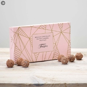 This stylish box of luxury salted truffles chocolates is the perfect finishing touch to any of the beautiful fresh flower deliveries that Sandra's Florist can arrange. It is presented in a stunning black and gold designed box finished with gold ribbon (160g).