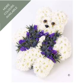This distinctive teddy bear tribute is created with double spray chrysanthemums. The waistcoat is created with a selection of small headed flowers in either pink tones or blue tones. Sandra's Florist will skilfully create and carefully hand deliver this floral teddy bear.