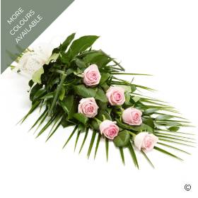 6 large-headed Roses are presented with Fatsia, Palm and complimented foliage to create this simple, classic Rose sheaf. Sandra's Florist will carefully create and hand deliver this simple rose tribute.