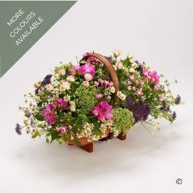 A country garden selection of flowers including Spray Roses, Freesias and others at their seasonal best. Complemented with Dill and foliages including herbs, presented in a traditional trug basket. Available in pinks and blues or Yellow and cream.