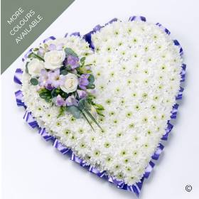 A classic heart-shaped funeral tribute, based with a mass of white Double Spray Chysanthemums the perfect base for the spray of large-headed Roses and scented Freesia that are complimented with dainty flowers and foliage. The tribute can be skilfully created by Sandra's Florist in colour tones of lilac and white, red and white, or yellow and white.
