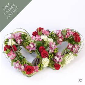 Mini Cymbidium Orchids, Carnations, Calla Lilies and Roses are some of the flowers included in this beautiful double heart tribute. Sandra's Florist will skilfully create this beautiful design that sees the fresh flowers and complimenting foliage nestled into two open heart shapes. The design is available in the mixed red, pink, cream and green colours, or the vibrant yellow and green tones.