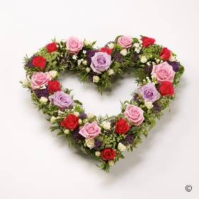 This beautiful open heart tribute is created with a selection of Large-headed Roses and Spray Roses in lilac, cream, cerise and pastel pink. The flowers will be skilfully arranged by Sandra's Florist nestled into an open heart shape finished with complimenting. foliage.