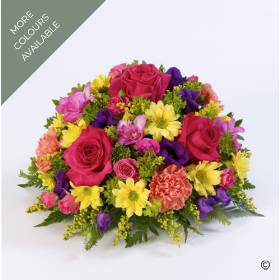 A classic selection of mixed flowers including large-headed roses, freesias, lisianthus and spray chrysanthemums complimented with foliage. Sandra's Florist can offer this posy tribute in three colour options: vibrant, pink and lilac or yellow and white