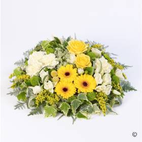 This woodland styled posy includes large-headed roses, carnations, spray chrysanthemums and germini and solidago. The posy had a natural combination of foliage including ivy that completes this this white, yellow and green posy design that is skilfully created by Sandra's Florist.