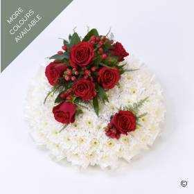 A classic based posy design created using a bed of massed white Double Spray Chrysanthemums. The funeral posy is completed with a spray of roses, berries and complimenting foliage and edged with coordinating ribbon. Sandra's Florist can create this tribute in red and white or pink and white.