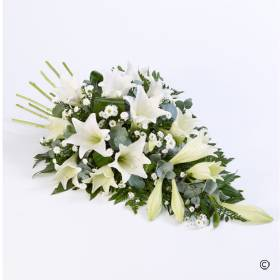 Classic white Longiflorum lilies are beautifully complemented by complimenting white flowers and choice foliages to create this elegant spray that will be skilfully created by Sandra's Florist.