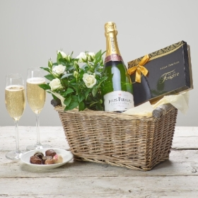 Here's a gift that combines so many favourites, a beautiful rose plant, irresistible chocolates and fine Jules Feraud champagne. Sandra's Florist will present this gift in a lovely wicker basket, it will mark any occasion perfectly.