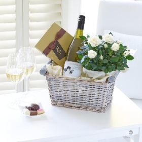 Imagine how pleased they'll be when they discover your gift includes wine, flowers and chocolates. You can select from Orchid red wine Rose wine or white white, a box of 115g premium quality Maison Fougère luxury chocolates and a stunning flowering rose plant. It's all presented in a pretty wicker basket and we at Sandra's Florist will create this gift and carefully hand deliver it, it's sure to delight.