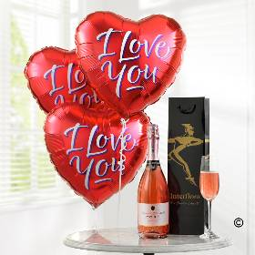 Show just how much you care with this fun gift of balloons and bubbly. Imagine their surprise and delight when they see three bright red heart balloons displaying those magic words 'I love you' for all to see. This gift also includes a bottle of sparkling rosé to add to that extra special feeling. This gift is sure to make them smile with pleasure.