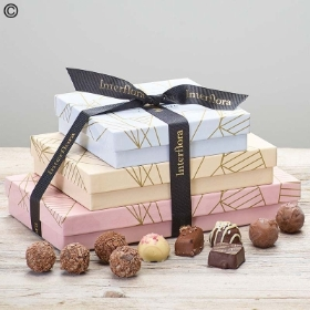 This trio of Chocolates Gift Set is created with a selection of Belgian Truffles, Chocolate Truffles and Belgian Salted Truffles Chocolates and a box of the Belgian Milk Chocolates classic range. Sandra's Florist are pleased to deliver this own it's own, or with a beautiful fresh flower gift or with Wine or Champagne, Soft toys, or Balloons.