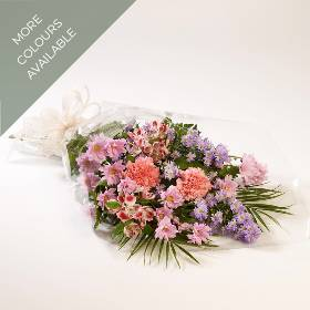 A selection of seasonal flowers in  tied with foliage to create a simple bouquet. This item will be created using a selection of seasonal flowers with varying content selected by our skilled florist and then carefully hand delivered by Sandra's Florist.