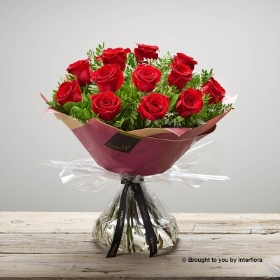 In our bestselling Dramatic Dozen bouquet, features quality large headed red roses with complimenting foliage. The hand-tied bouquet will be skilfully created by one of the Sandra's Florist team and gift wrapped and presented in beautifully for the ultimate valentines bouquet.
