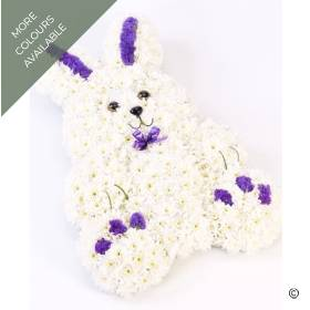 This sweet floral tribute in the shape of a rabbit features fresh white double spray chrysanthemums and contrasting dainty flowers trimmed with a matching ribbon bow. Sandra's Florist can create this rabbit funeral design in white and blue or white and pink.
