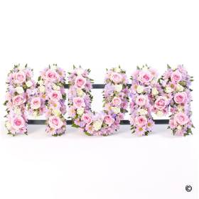 This Mum tribute is created by arranging carefully selected fresh flowers including pink roses, freesia,  Spray Carnations, chrysanthemum and other dainty flowers, along with complimenting foliage to complete this personal design that  Sandra's Florist will skilfully create and carefully hand delivered.