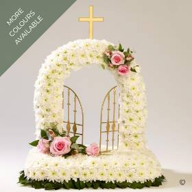 This gates of heaven design is created with a base of white double spray chrysanthemums and finished with sprays of roses complimenting flowers, the design is completed with the selection of choice foliage. Sandra's Florist can create this design in two colour ways Pink and White or white and green.