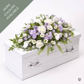 This delicate Child's casket spray arrangement includes pure white calla Lily and large-headed roses contrasted with sweetly fragrant lilac freesia, lisianthus and dainty complimenting flowers. This beautiful small spray is trimmed with foliage a selection of foliage including ruscus and ivy trails.  The skilful florists at Sandra's will lovingly create this tribute to bring whatever comfort they can through creating a beautiful funeral tribute.