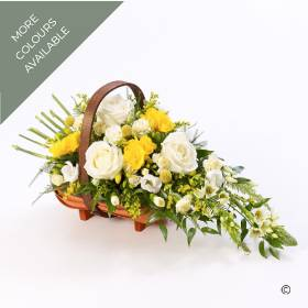 A traditional trug basket filled with roses, scented freesia, spray carnations and complimenting seasonal flowers. Available in white and yellow or Pink and lilac, Sandra's Florist will carefully arrange in a sheaf-like design before hand delivering.