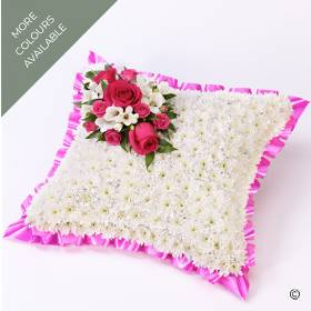 A classic cushion-shaped design created using a base of massed of white double spray chrysanthemums and finished with a beautiful spray of flowers including roses and freesias, the design is framed with coordinating coloured pink ribbon.  The beautiful funeral tribute is available in three colours pink and white, Pale pink & white, Red and white.