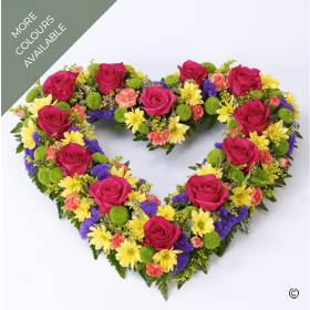 The perfect tribute for a loved one, this open heart shaped display available in two colour tones, a vibrant selection or yellow and white. The flowers selected by Sandra's Florist include roses, spray chrysanthemums, spray carnations, other complimenting flowers and foliage.