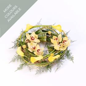 This wreath is perfect for a woodland burial but would be a beautiful natural tribute at any funeral. The designs is created with calla Lily and cymbidium orchids or Large Headed roses and other accompanying flowers entwined with cornus stems. The complimenting foliage is an important feature that adds to the flowers and circular willow frame that Sandra's Florist skilfully to create this woodland wreath onto. This natural tribute is available in two colour options: yellow and green or pink shades.