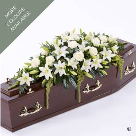 Beautiful Asiatic Lily and large-headed Roses are used to create this elegant casket spray. The fresh flowers are enhanced with a selection of foliage including ruscus, aralia leaves and eucalyptus. This striking tribute that dresses the coffin top is available in Red, White, Pink, and Yellow. It will be skilfully created and carefully hand delivered by Sandra's Florist.