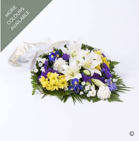 This sheaf of fresh flowers is simply arranged and presented wrapped and tied with a ribbon. The selection is available with two colour options: blue, white and yellow or pink, blue and white. The flowers includes cream Asiatic Lily, blue iris, carnations, spray chrysanthemums with other complimenting flowers and a selection of foliage. Once created the funeral flowers will be carefully hand delivered by Sandra's Florist.