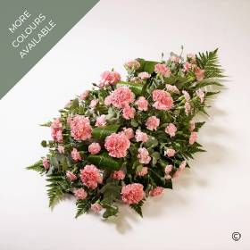 This traditional floral tribute includes a generous selection of fresh carnations, spray carnations and choice foliage to compliment the classic flower selection within this single-ended spray.  The flowers will be skilfully arranged by Sandra's Florist  are in a single distinctive shade of colour: Red, Pink, White or Yellow & White.
