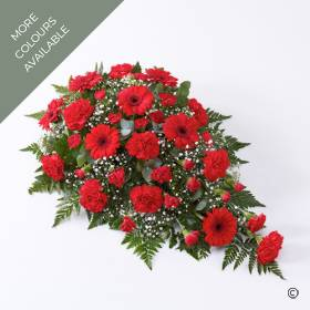 This striking floral tribute includes a generous selection of fresh carnations, spray carnations and germini. The flowers carefully selected by Sandra's Florist  are in a single distinctive shade of colour: Red, Pink, White or Yellow & White. The flowers are expertly arranged in a traditional single-ended teardrop spray and finished with complimenting foliage.