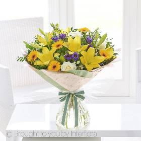 Spring is the inspiration for this gift, it's yellow with a touch of purple and white are the true colours of the season. These exquisite lilies and germini are contrasted with rich purple lisianthus, the pale velvety roses add a hint of luxury to this designs that will be skilfully created and beautifully gift wrapped by Sandra's Florist.