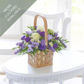 Allow Sandra's Florist to hand deliver this gift that looks and smells delightful, they're sure to be impressed with your choice. This charming basket is a beautifully arranged selection of delicate lilac and cream flowers – and the soft fragrance is thanks to these gorgeous freesias. Perfect!