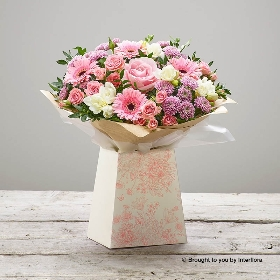 This charming gift box filled with pretty pink and white flowers features white freesia, pink germini, pink rose, pink spray chrysanthemums, a pink spray carnation and lilac statice with complimenting foliage. Skilfully created by Sandra's Florist It makes a very feminine gift for someone special.