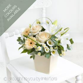 It's the timeless beauty and elegance, along with the simplicity of this arrangement is what makes it special. Sandras Florist will arrange the freshest exquisite large-headed roses, graceful lilies and a beautiful selection of germinis, lisianthus and spray chrysanthemums to create this chic display before carefully hand delivering it.