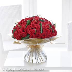 These fifty irresistible large-headed red Roses are the absolute essence of a grand romantic gesture. Sandra's Florist will hand create this breath-taking designs with 50 of the highest quality large headed 'red naomi' red roses, they'll be hand-tied with aspidistra leaf and bear grass, and finished with sumptuous gift wrapping and luxurious organza ribbon, this exquisite display is the perfect way to send your love to someone special.